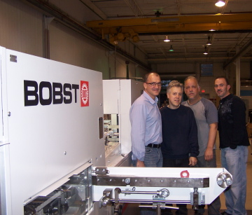 Left to Right, Jorge Perez of Bobst, George and John Esteva, owners of Dynamic Die Cutting & Finishing Corp., and Angel Rios, Bobst.