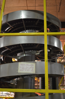 A Ryson International dual spiral conveyor is used at the end of the Moosehead packaging line to transport cases of beer bottles from an overhead line down to shipping.
