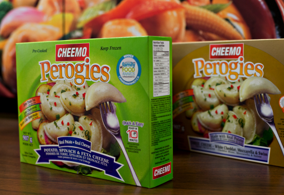 Two of the 12 perogy flavors manufactured under the flagship CHEEMO brand label by Heritage Frozen Foods at its 80,000-square-foot production plant in Edmonton.