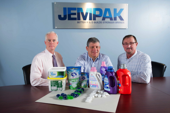 From Left: JemPak president Steve Miller, chief executive officer Charles Zuckerman, and vice-president of operations Emil Tarnowsky show off some of the high-quality dishwasher and laundry detergents manufactured in various packaging formats for its private-label customers at the company's Ontario-based production facilities in Concord and Oakville.