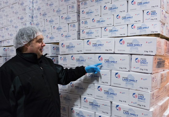Company president John Neate inspects one of the many highly-stacked loads of product being kept at a perfect freezing temperature of -18°C inside the plant's expansive cold-storage warehouse while awaiting shipment to foodservice and retail customers.