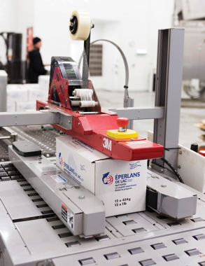 Equipped with an Accuglide three-tape head, the 3M-Matic case-sealing machine from 3M Company applies strips of 3M's Tartan 369 clear tape onto the filled five-kilogram boxes of product just prior to the final metal detection test.
