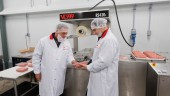 BestCo Foods president Dino Scopelleti (left) and son and vice-president Vincent examine the high-quality pack seal created by the model VC999 RS420c rollstock thermoformer.