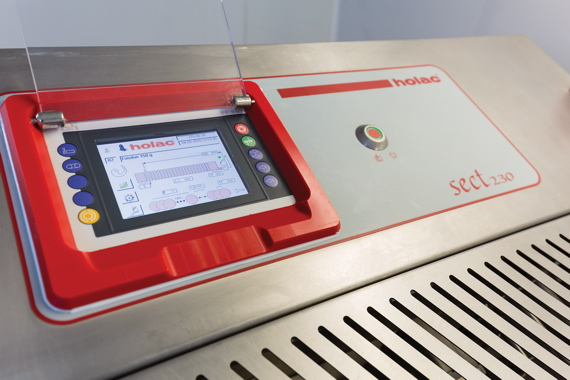 A close-up of the easy-to-use touchscreen operator control panel on the Reiser-supplied Holac Sectomat 230 industrial slicer used by the Gibiers Canabec processing plant.