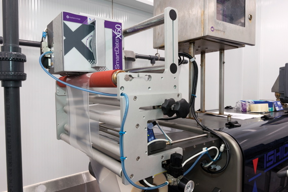 Integrated with an Ishida tray-sealer supplied by Techno-Pak, a model SmartDate X60 thermal-transfer coder from Markem-Imaje applies all the required product codes on top of the product labels attached onto the finished plastic clamshell packages.