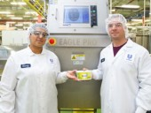 Production manager Mandeep Atwal (left) and factory director Galen Sienicki pose in front of one of the Rexdale plant's high-performance Eagle Pro X-Ray product inspection systems installed to ensure optimal food safety standards.