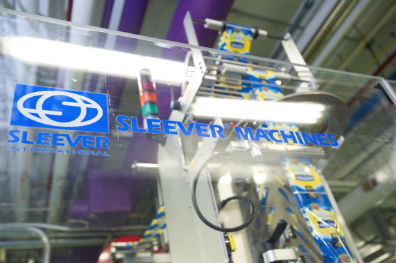 A new high-speed shrinksleeving machine from Sleever International used to decorate the new squeeze-bottles.