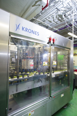 A Krones Canmatic rotary filler used to package round jars of Hellmann's mayo.