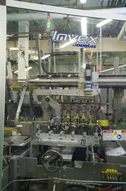 The Invex IM wraparound case/tray-packer with a lane-divider from Douglas Machine.