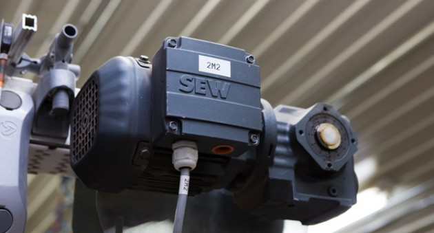 A close-up of an SEW-Eurodrive motor that helps provide the power to the FlexLink X85 wedge conveyor system.