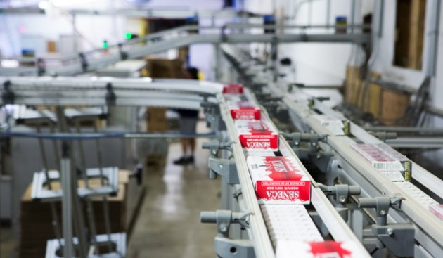 Grand River Enterprises utilizes a high-speed X85 wedge elevating conveying system with bends, manufactured by FlexLink Systems Canada to move cartons of tobacco products.