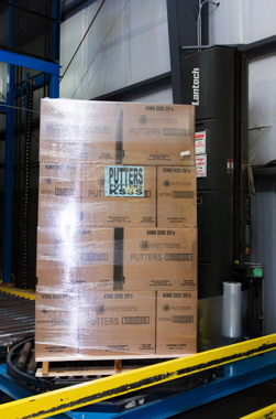 A Lantech stretchwrapper quickly secures a pallet of cigarettes.