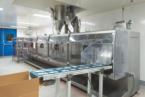 Packages coming out of the high-speed form/fill/seal unit-dose packaging machine are conveyed into the shipping box.