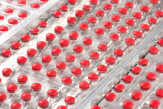 Close-up of blister-packs being formed at high speeds.