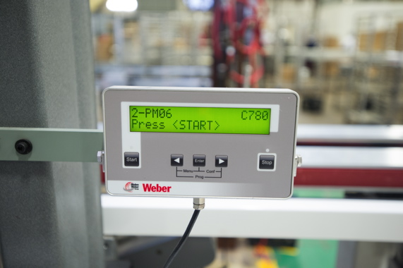 A touchscreen operator control panel for the high-speed Weber print-and-apply labeling system enables user-friendly operation and fast product changeovers at the busy plant.