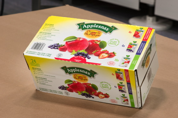 A 24-pack of Applesnax Organic applesauce pouches packaged inside a colorful pre-printed corrugated case produced by Norampac, a division of leading Canadian forest products group Cascades Canada Inc.