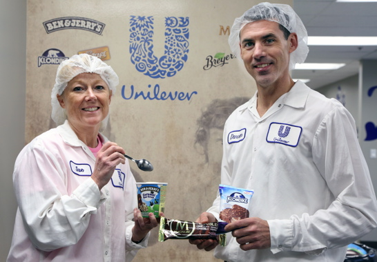 Unilever Canada Inc. quality manager SueAnn Nobbs and senior operations manager of ice cream Darren Vanbesien show off samples of some of the Ben & Jerry's, Magnum and Klondike ice cream brands manufactured at the company's FSSC-certified production facility in Simcoe, Ont.