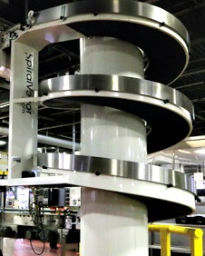 The SpiralVeyor vertical conveyors manufactured by AmbaFlex are used throughout the 225,000-square-foot plant to enable smooth and gentle transfer of filled cases of Coca-Cola cans to the building's end-of-line packaging area for palletizing and stretchwrapping.
