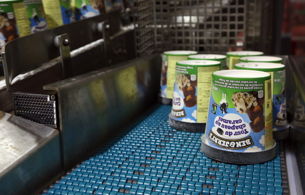 Highly hygienic SystemPlast belting from Regal Beloit is used to carry tubs of Ben & Jerry's ice cream on a conveyor line manufactured by Descon Conveyors.