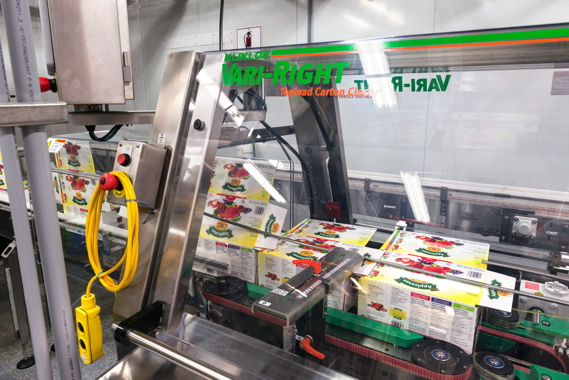 Integrated into the production line by StrongPoint Automation, a Kliklok Vari-Right top-load carton closer is used at Leahy Orchards to seal 24-packs of its own Applesnax Organic brand of 90-gram applesauce pouches.