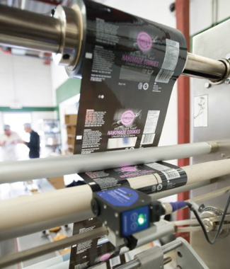 The automatic film registration on the Sleek 50 Wrapper machine helps ensure uniform package consistency for each run.