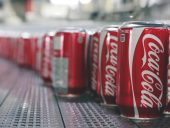 Manufactured by the Ball Packaging production facility in Whitby, Ont., the lightweight 355-ml aluminum cans of Coca-Cola are automatically rinsed and conveyed towards filling stages just above a high-volume blower positioned underneath to remove all excess moisture from the cans.