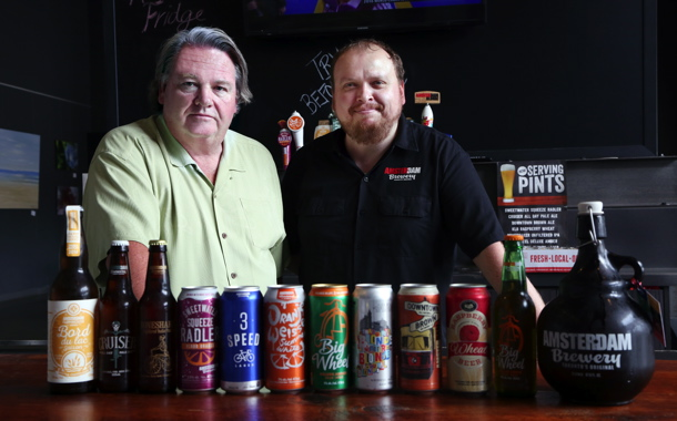 Amsterdam Brewing Company owner Jeff Carefoote (left) and brewmaster Iain Mc-Oustra show off some of the company's premium-quality products and different packaging formats at the retail storefront at the entrance to the company's 65,000-square-foot brewery located in Toronto's trendy Leaside neighborhood.