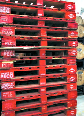 The Collective Arts beermaking plant in Hamilton uses a variety of pallets to ship its product, including those manufactured and rented out by PECO Pallets, Inc.