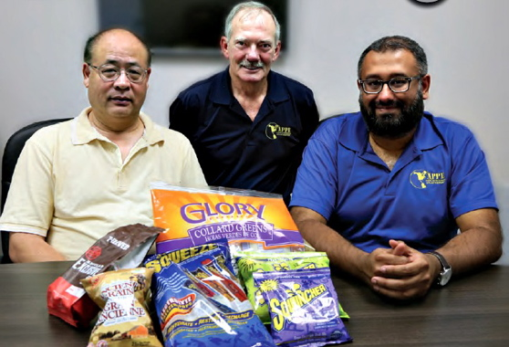 From Left: APPE team members displaying some of the flexible packaging produced on the Vertobagger 2.0 machine include mechanical engineer Winston Lu, national service manager Bob LeClair, and national sales manager Al Aman.