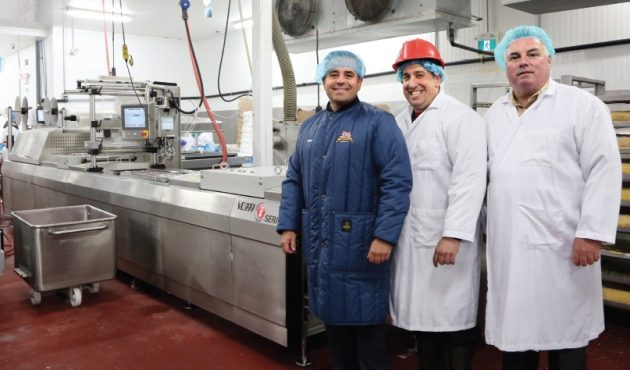 From Left: The Elite Meat Company's president Dan Milanovic, plant manager John Longo, and director of sales Peter Daly strike a pose in front of the hardworking iSeries thermoforming system, manufactured by the Swiss-based food packaging machine-builder VC999, at the company's 28,000-square-foot meat-processing and packaging facility in Ajax, Ont.