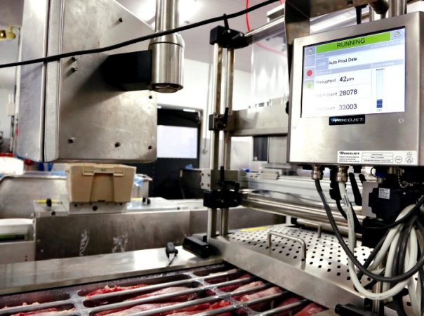 Set atop the VC999 iSeries thermoform machine, a Videojet coding machine applies best-before dates and lot code data onto the as-yet-to-be-applied top web film of the pork tenderloin packs.