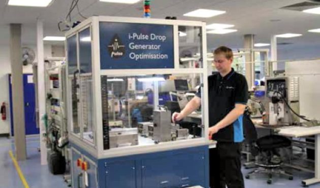 A Cambridge plant employee carrying out quality assurance tests on the i-Pulse printhead.