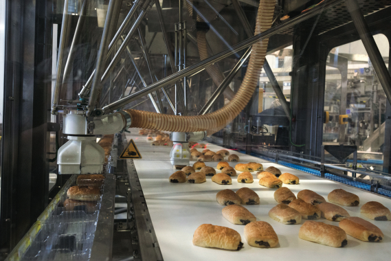 The model P4 Delta-3 robot kinematics manufactured by Schneider Electric gently and quickly pick up chocolate buns and place them neatly into plastic trays on the De La Ballina packaging line operating at the Le Petite Bretonne baked goods manufacturing facility in Blainville, Que.