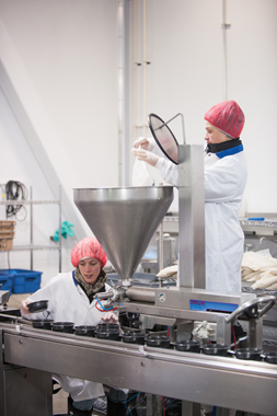 HFS uses a Universal1000i food depositer and filler manufactured by Unifiller Systems to ensure accurate placement of food items into plastic trays.