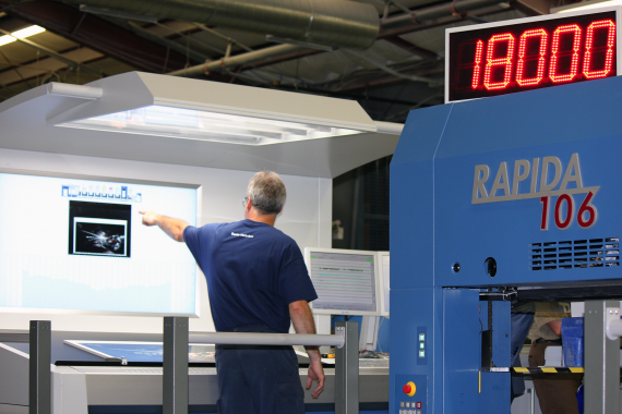 The KBA live-image QualiTronic ColorControl wall screen provides the Rapida 106 press operators with a visual inline color measuring system to ensure print integrity is maintained throughout the run. Photo by Andrew Joseph.