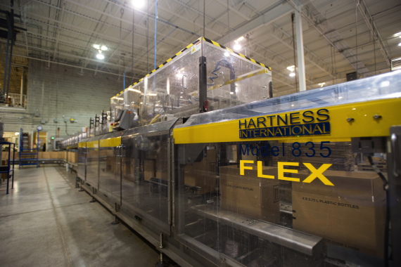 A Model 835 case-packer manufactured by Hartness International was purchased by Recochem from Canadian agents Alex E. Jones & Associates.