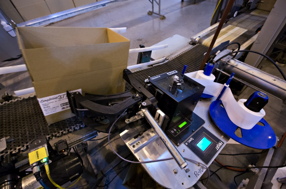 Also supplied by Harlund Industries, a FoxJet model LS6000 printer-applicator quickly attaches a corner label onto a carton just before it is verified a Cognex vision system.