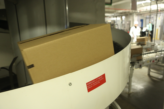 A sealed corrugated case filled with breakfast cereal products makes its way up around the bend of a Ryson spiral conveyor to the palletizing area of the facility.