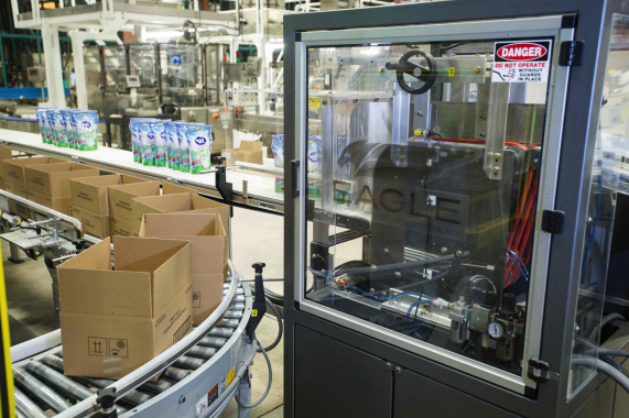 Boxes coming out of Eagle's Boxxer T-12 automatic case-erector travel alongside neat rows of stand-up pouches exiting the nearby Eagle collator to be packed for shipping.