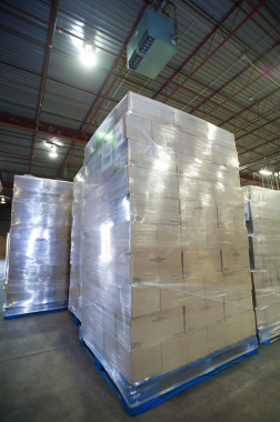 Fully-palletized finished loads are placed onto the signature-blue CHEP pallets and secured into place with protective film on one of the plant's three stretchwrappers.