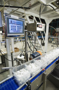 Each filled plastic tub traveling on top of the Speedway plastic conveyors is checked for weight and quantity by the Multiweigh checkweighers prior to lidding and labeling.
