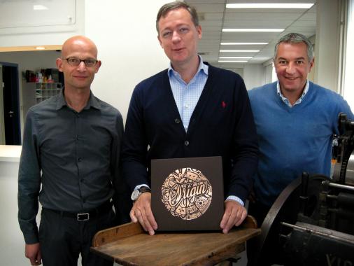 Erwin Heeren, Tom Du Caju and Koen Penne of Du Caju Printing & Packaging proudly display The Origin Box. Image © Iggesund.