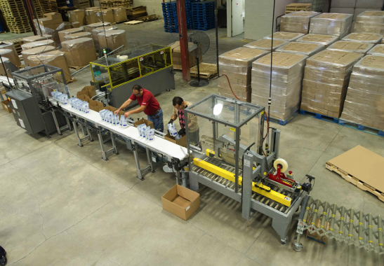 A bird's-eye view of one of the plant's two highly-automated packaging lines utilizing high-speed collating, box-erecting and case-sealing equipment from Eagle Packaging.