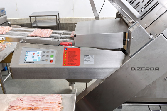 A Bizerba Scaleroline A550 automatic industrial slicer provides integrated weighing technology for high-precision portioning of the Edelweiss veal bacon products.