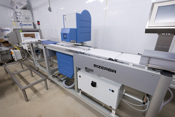 After product is packaged, it moves to a Bizerba Master weigher and top and bottom labeler before exiting through a Sesotec metal detection unit (left).