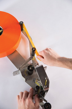 Manufactured by Shurtape Technologies, the QuickChange Sealing System (left) is the company's latest advancement of its patented ShurSEAL Solution technology for producing reliable, tamper-evident seals at optimal line speeds.