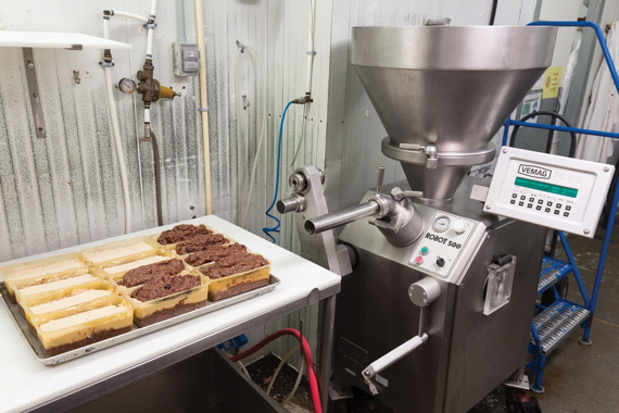 A layered mousse product is created via a Vemag Robot 500 vacuum filler distributed by Reiser Canada, equipped with double-screw technology.