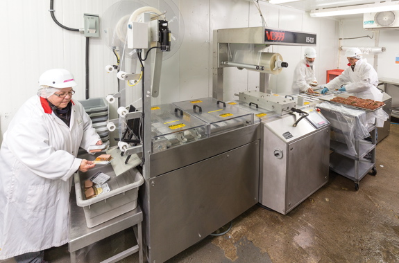 Workers at the Gibiers Canabec processing plant use a VC999 RS420 rollstock thermoformer to pack the company's popular Porto Liver Parfait product.