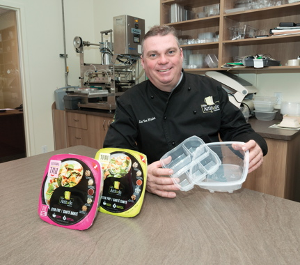 Veg Pro International's R&D manager Luc Van Winden proudly shows off the patent-pending, two-piece, multicompartment microwavable polypropylene bowls use to package the company's recently-launched Fresh Attitude Asian Stir Fry kits, which use a unique steaming process to bring all of the ingredients to the perfect serving temperature in minutes.