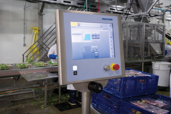 An intuitive touchscreen HMI (human-machine interface) terminal helps facilitate operator-friendly programming and quick product changeovers for workers using the high-volume Multivac model T800 tray-sealer to seal the Fresh Attitude Asian Sir Fry kits at the fast-paced Veg Pro International value-added processing plant in Sherrington, Que.